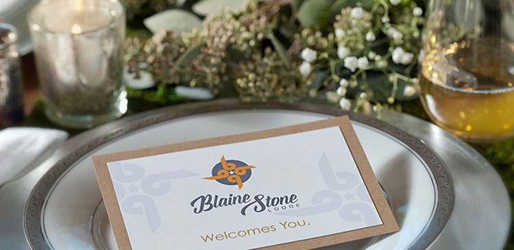 Blaine Stone Lodge branded welcome card on a table
