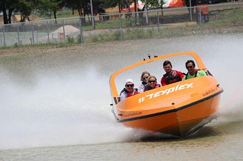 guests enjoying a jet boat ride at TexPlex Park