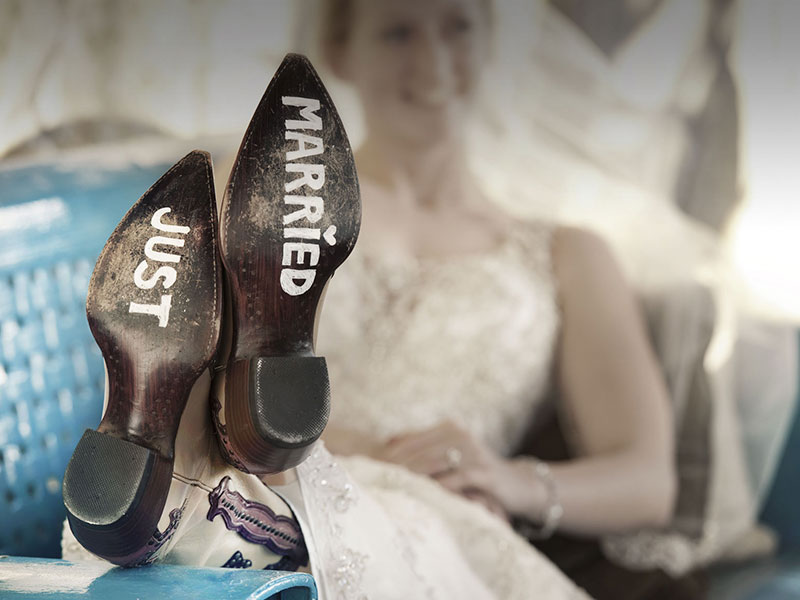 woman with just married painted on her boots